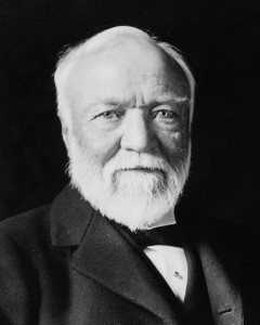 Andrew_Carnegie,_three-quarter_length_portrait,_seated,_facing_slightly_left,_1913-crop